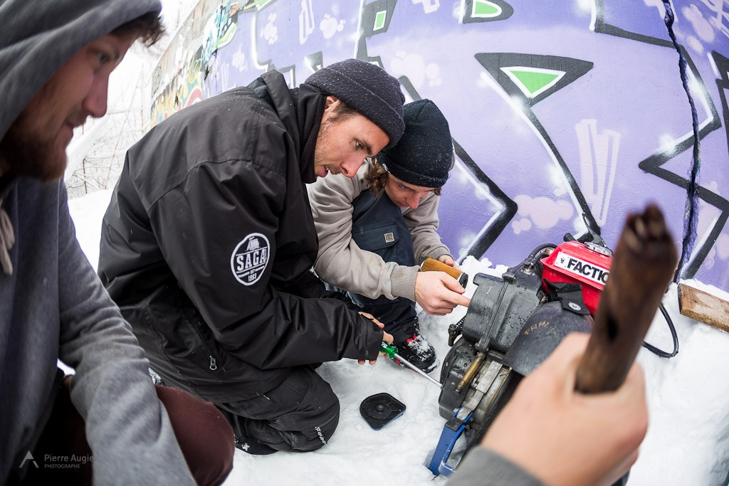 Etienne Merel, Tom Granier & Hugo Bonnifay fixing a winch during a freeski street session.