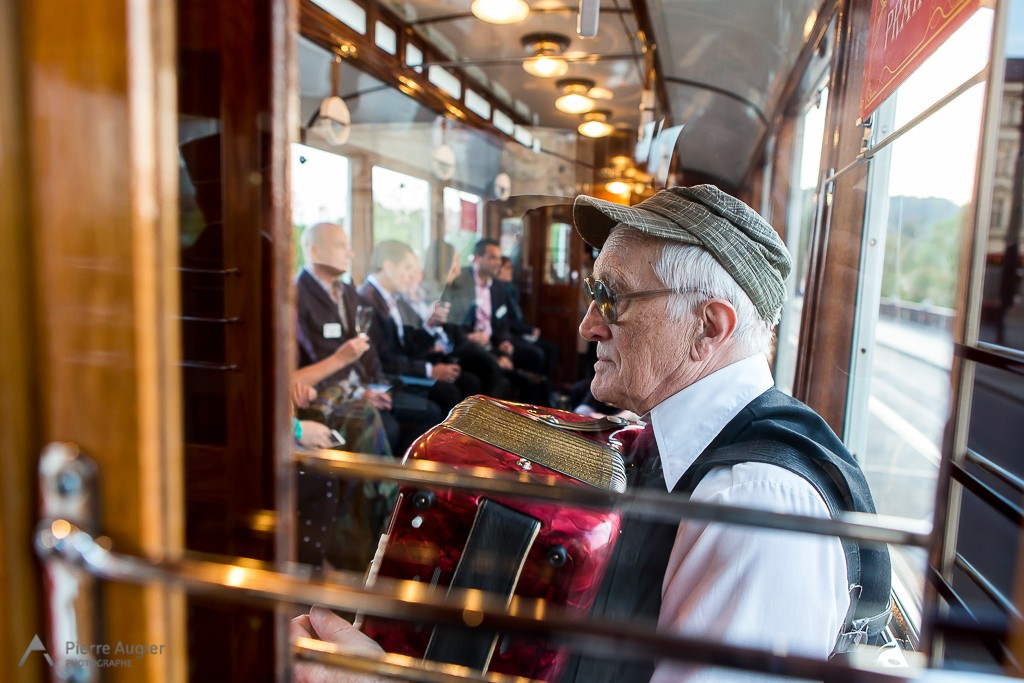 An accordion player in an old Czech tramway in Praha